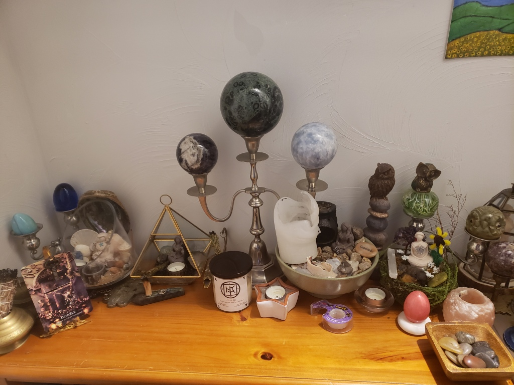Witch altar located in a closet filled with witcy decor, witch tools, and a lovely witch aesthetic